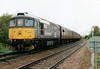 33025, in DRS Minimodal livery, is on the rear of 1Z47 'Fenman', at Badgeney Road LC, 01/05/06.