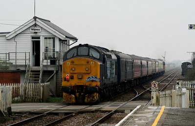 37667, on the rear of the 'Norfolk Broadsman' as it passes Manea Signalbox, will head the train from Ely to Norwich, 05/03/11.