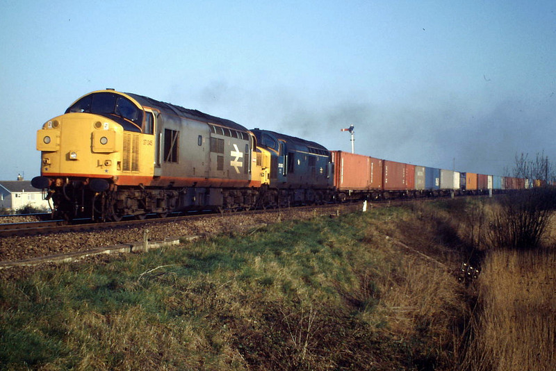 37065 and 37063 approach Silt Road LC on 4E97 Coatbridge - Felixstowe freightliner, 04/88.