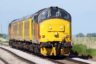 37421 heads 1Q08 Derby RTC - Ipswich, trailed by 37219 JONTY JARVIS, passing Whitemoor Drove, 30/05/21.
