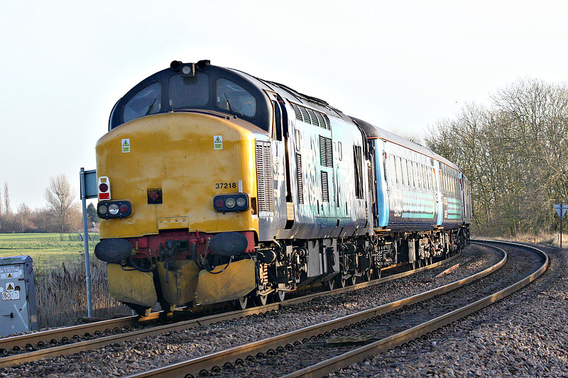 37218 and 47790 sandwich DRS coaches 5919 and 5971 on 5Z68 Crewe Holding Sidings to Norwich Crown Point as they pass Silt Road LC, 08/01/15. Is this new stock for the short set perhaps?
