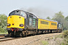 37607, tailed by 37605, roars towards Silt Road LC, both locos going like the clappers, on 1Q04 Derby RTC - Norwich, 19/05/14.
