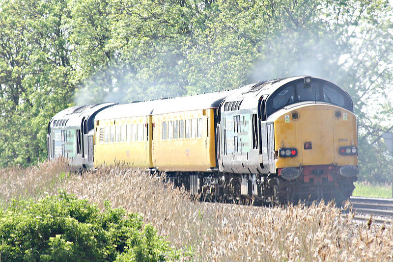 37605, lead by 37607, passes Silt Road LC, both locos going like the clappers, on 1Q04 Derby RTC - Norwich, 19/05/14.