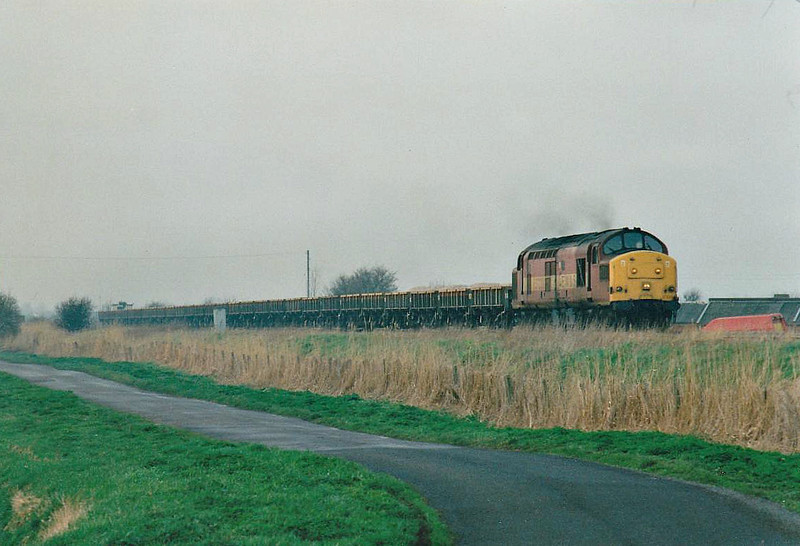 37220 heads east past Horsemoor on a ballast train, 12/03/99. This loco was withdrawn in 01/00 and scrapped.