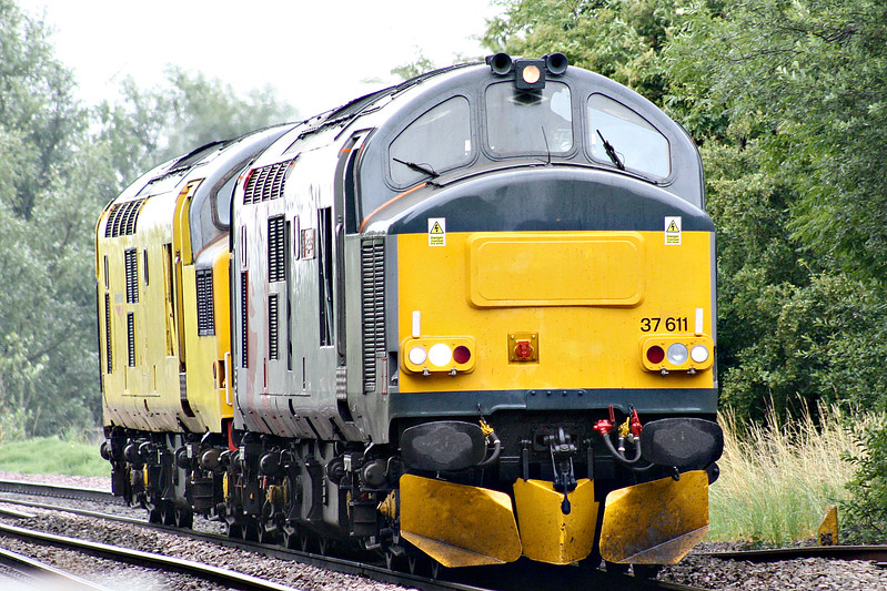 37611 PEGASUS, owned and operated by Europhoenix Ltd., tows 97301, formerly 37100, towards Badgeney Road AHB on a Cambridge - Derby RTC train, 28/06/17. 97301 had failed at Cambridge on test train the pervious week.