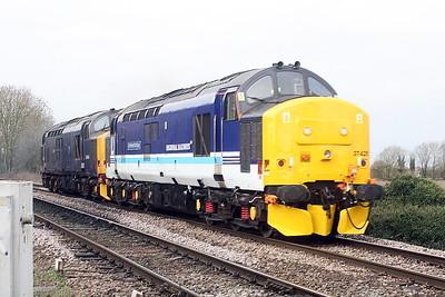 37425 SIR ROBERT McALPINE, on this side at least, in very nice Regional Railways livery, leads 37422 past Badgeney Road AHB on 0Z37 Crewe Gresty Bridge - Norwich, 28/01/21.