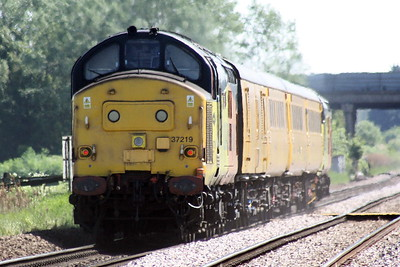 37219 JONTY JARVIS brings up the rear of 1Q08 Derby RTC - Ipswich, headed by 37421, passing Whitemoor Drove, 30/05/21.