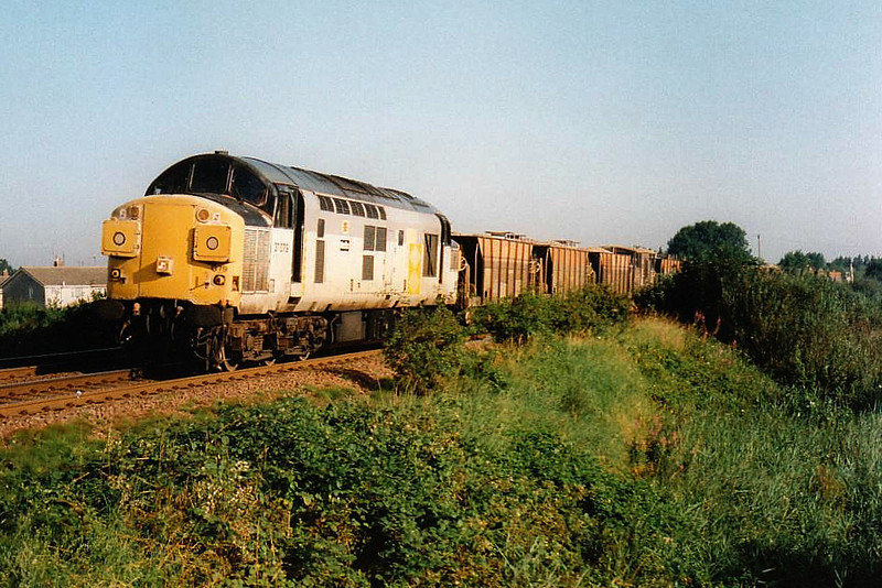 37079 MEDITE heads east past Silt Road LC on a ballast train, 30/07/97. This engine was withdrawn 11/98.