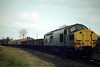 37102 waits to return to Whitemoor from Wisbech with a good rake of steel and coal empties, 03/82