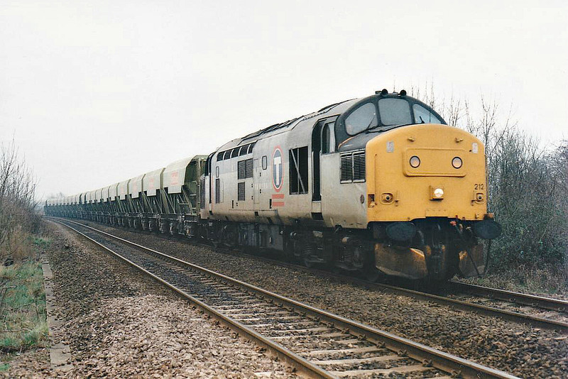37212 is unusual power on 6M66 Broxbourne - Mountsorrel Redland S/D empties, running 6 hours late as it passes Badgeney Road LC, 29/01/98. I suspect the train loco had failed en route. This loco was withdrawn 04/99.