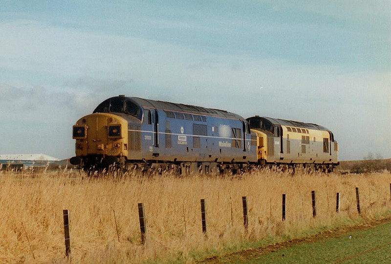 37023 STRATFORD and 37046 head for Peterborough past Whitemoor Drove, 14/02/97. 37023 was withdrawn 12/99 and is now preserved whilst 37046 was withdrawn 10/00.
