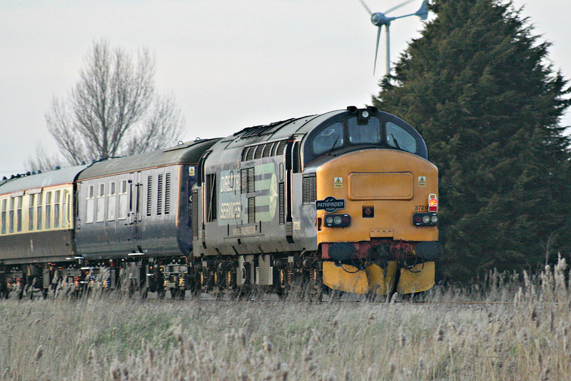 37218 is on the rear of the returning 1Z39 Wymondham - Crewe 'MNR Navigator' Railtour headed by 37 402/409 as they pass Horsemoor, 08/03/14.