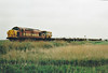 37042 passes Horsemoor on a westbound CWR empties train, 11/05/98. This engine was withdrawn in 01/05 and is now preserved.