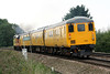 37421 is clagging for gold as it paases Silt Road LC on 3Q77 Derby RTC - Norwich/Yarmouth/Lowestoft test train, 19/09/16. The DVT 9702 is one of the old GEML vehicles........ and, yes, I have straightened this picture up! Not many verticals in the Fens!