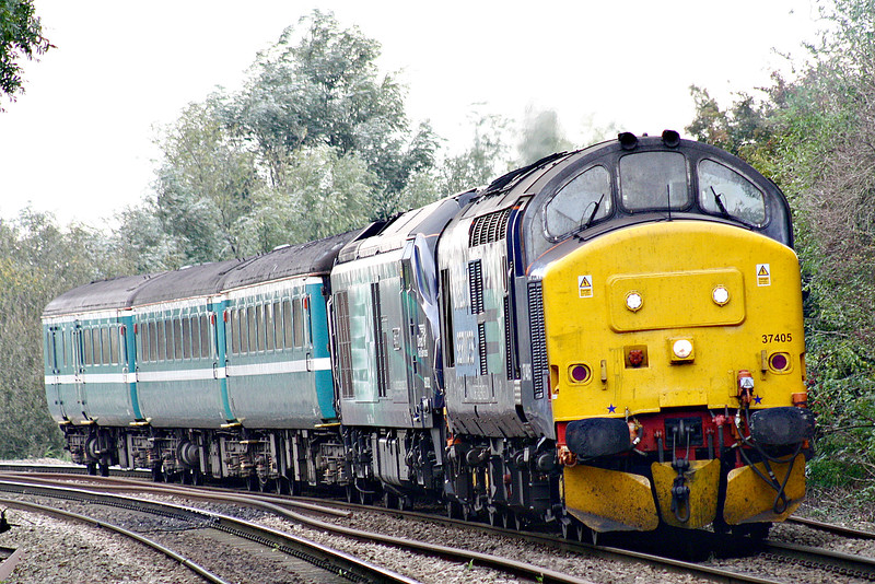 37405 hauls 68022 DIT approaching Badgeney Road AHB on 5Z20 Norwich Crown Point - Crewe Carriage Sidings composed of debranded Anglia Mark 2's, 13/10/16.