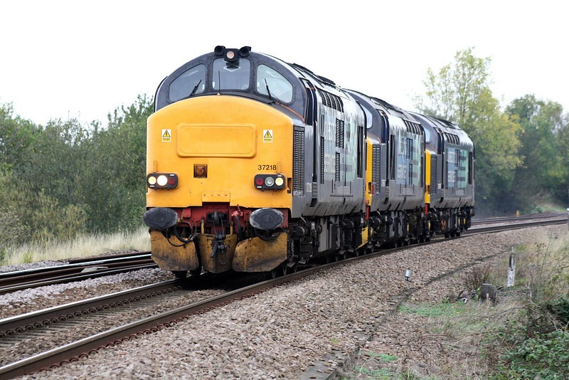 37218 leads 37667 and 37059 towards Silt Road LC as 0Z37 Crewe Gresty Bridge - Stowmarket for RHTT duties, 13/10/11.