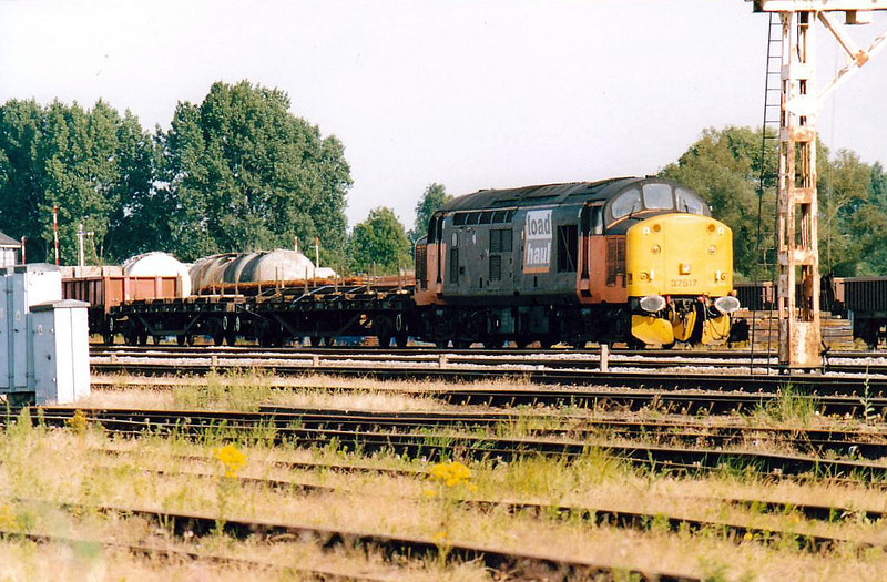 37517 sits in the Down Loop at March with a train for Grant Rail, 15/07/03.