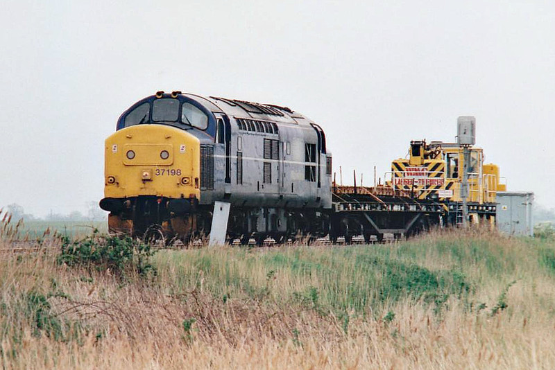 37198 heads west past Horsemoor on a sort engineer's train, 11/05/98. This engine was withdrawn in 12/99 and is now preserved at the Great Central Railway.