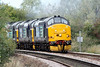 37688 rounds the bend from March South leading 0Z37 Crewe Gresty Bridge - Stowmarket for RHTT workings - only 37688 and 37194, second loco, are actually working - 11/10/11.
