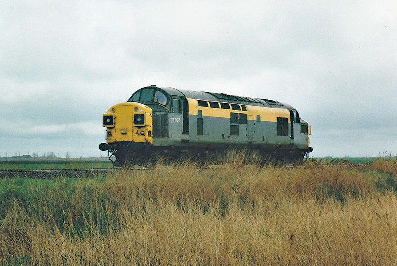 37097 heads west past Horsemoor, 15/04/98. This engine was withdrawn in 11/98 and is now in preservation.
