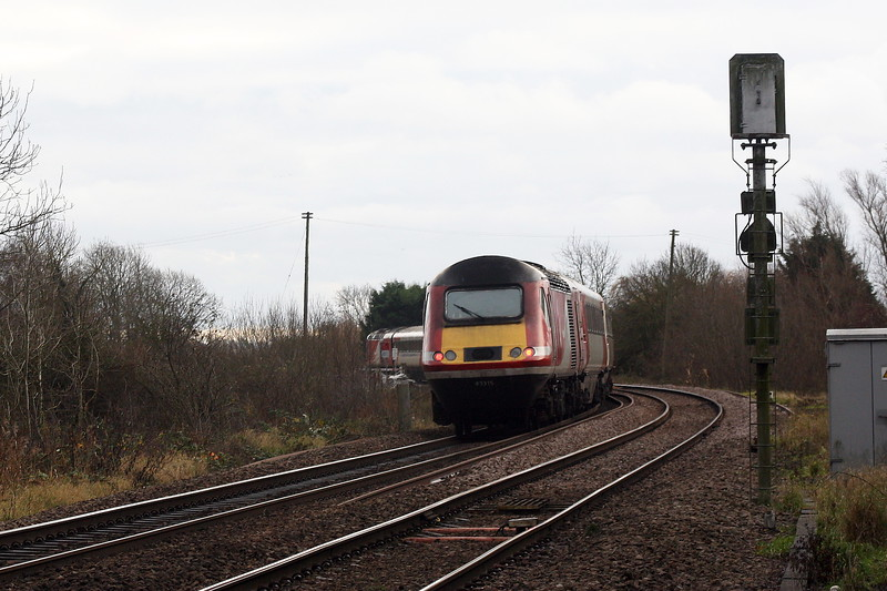 43315, debranded, is on the rear as it passes Badgeney Road AHB on a Leeds Neville Hill - Ely North Junction off Lease stock move. 43367 visible to the left, 05/12/19. The stock will go into storage and the power cars with return to Leicester. I'm not sure if this the first LNER set to go into storage.