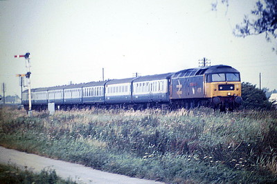 47578 THE ROYAL SOCIETY OF EDINBURGH passes Horsemoor on the Blackpool - Cambridge, 29/08/85. 47578 was built by Brush Falcon Works in 1964 as D1776 and was renumbered to 47181 in September 1973. It was ETHed and renumbered to 47578 in January 1981. In June 1994 it was fitted for multiple working and became 47776. It was withdrawn in April 2004 and in December 2013 became part of the West Coast Railways fleet, where it is currently in store.