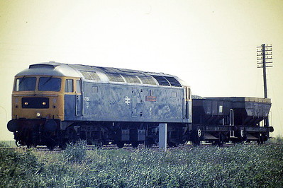 47580 COUNTY OF ESSEX approaches Horsemoor with a very short Down Ballast train, 31/07/87. 47580 was built by Brush Falcon Works in 1964 as D1762 and was renumbered to 47167 in December 1973. It was ETHed and renumbered to 47580 in May 1980. In June 1994 it was fitted for multiple working and became 47732. It was withdrawn in April 2004 and is preserved on the Mid Norfolk Railway.