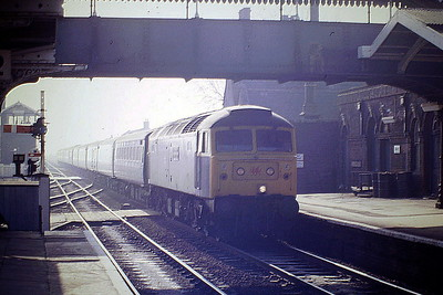 47616 THE RED DRAGON rolls into March Station on the Down 'European', 04/87. 47616 was built by Brush Falcon Works in 1966 as D1925 and was renumbered to 47248 in November 1973. It was ETHed and renumbered to 47616 in June 1984 and in August 1991 it was renumbered to 47671. It was fitted with high phosphorus brake blocks and an increased ETS rating, for dedicated use on Anglo-Scottish sleeper services, based at Inverness, reverting to 47616 in July 1994. In December 1994 it was fitted for multiple working as 47789. It was withdrawn in January 2004 and scrapped in May 2007.