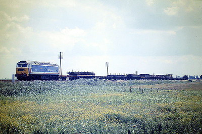 47576 KINGS LYNN straggles out across the Fen as it approaches Horsemoor on 9H76 Chesterton Junction - Peterborough, 03/08/87. 47574 was built by Brush Falcon Works in 1964 as D1769 and was renumbered to 47174 in February 1974. It was ETHed and renumbered to 47573 in February 1981. It was withdrawn in November 2002 and scrapped in May 2005.