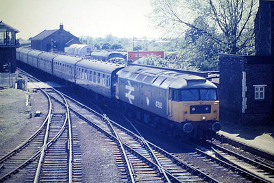 47593 GALLOWAY PRINCESS of Eastfield Depot slows for its March stop on the Down 'European', 06/85. 47593 was built by Crewe Works in 1965 as D1973 and was renumbered to 47272 in September 1974. It was ETHed and renumbered to 47593 in August 1983. In August 1991 it was renumbered to 47673. It was fitted with high phosphorus brake blocks and an increased ETS rating, for dedicated use on Anglo-Scottish sleeper services, based at Inverness. In October 1994 it was fitted for multiple working and became 47790. It was withdrawn in April 2004 and in August 2007 went to DRS and there to Locomotive Services Ltd in August 2018, where it had been renumbered to 47593.