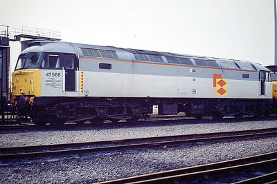 47588 sits on March Depot in Railfreight Distribution Sector livery ex-Works, 03/88. 47588 was built by Brush Falcon Works in 1964 as D1773 and was renumbered to 47178 in March 1974. It was ETHed and renumbered to 47588 in June 1983. In November 1995 it was fitted for multiple working and became 47737. It was withdrawn in March 2004 and scrapped in August 2008.