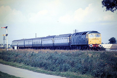 47628, in GWR Green livery, passes Horsemoor on 1E66 Birmingham New Street - Norwich, 04/08/87. 47628 was built by Crewe Works in 1965 as D1663 and was renumbered to 47078 in February 1974. In February 1978 47078 'SIR DANIEL GOOCH' collided with derailed tankers on a Southampton to Birmingham freight at Appleford north of Didcot. The non-driver side of the No.1 end cab was badly damaged and the loco was stored for a time at Oxford before being removed to Crewe for repairs. In January 1985 it was one of four locos given a complete GWR makeover in connection with GWR 150 and it was ETHed and renumbered to 47628. It was withdrawn in September 1999 and scrapped in March 2006.