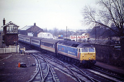 47573 THE LONDON STANDARD runs into March Station on the Down 'European', Harwich Parkeston Quay - Manchester, March's premier passenger service, 24/02/87.  47573 was built by Brush Falcon Works in 1964 as D1768 and was renumbered to 47173 in January 1974. It was ETHed and renumbered to 47573 in February 1981. In January 1994 it was fitted for multiple working and became 47762. It was withdrawn in January 2001 and scrapped in October 2005.