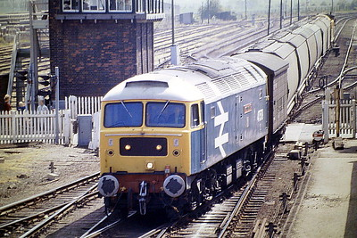 47579 JAMES NIGHTALL GC takes the road for Whitemoor at March East on 9H76 from Kings Lynn, 29/05/87. March is justly proud of the two heroes of the Soham disaster of June 2nd, 1944. 47579 was built by Brush Falcon Works in 1964 as D1778 and was renumbered to 47183 in February 1974. It was ETHed and renumbered to 47579 in March 1981. In December 1995 it was fitted for multiple working and became 47793. It was withdrawn in March 2004 and preserved at the Mangapps Railway Museum.