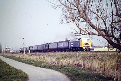 47572 ELY CATHEDRAL passes Horsemoor with ECS of the Royal Train, 16/04/87. 47572 was built by Brush Falcon Works in 1964 as D1763 and was renumbered to 47168 in September 1973. It was ETHed and renumbered to 47572 in January 1981. It was withdrawn in August 1999 and scrapped in January 2000.