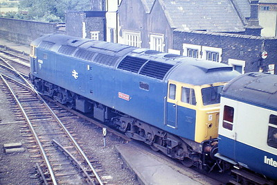 47623 VULCAN passes through March Station on an SSO special bound for Yarmouth, 07/85.47623 was built by Crewe Works in 1965 as D1676 and was renumbered to 47090 in March 1974. It was ETHed and renumbered to 47623 in November 1984. In March 1990 it was converted to long range 47843. It was withdrawn in September 2002 and passed to Freightliner, who sold it to Riviera Trains in January 2005, who in turn passed it on to DRS in October 2006. In August 2018 it went to the Rail Operations Group where it is in store.