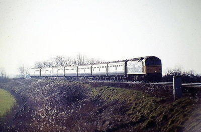47646 approaches Silt Road LC on the Down 'Rhinelander' (ex 'European'), 23/02/88. 47646 was built by Crewe Works in 1965 as D1658 and was renumbered to 47074 in February 1974. It was ETHed and renumbered to 47646 in February 1986. In February 1990 it was converted to long range 47852. It was withdrawn and scrapped in August 1992.