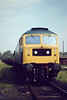 47075 waits to return to Whitemoor, brakevan only, 15/05/81. Note steel empties behind.