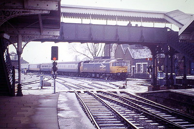 47631 runs into a snowy March Station to stop on the Down 'European', 22/12/86. 47631 was built by Crewe Works in 1965 as D1643 and was renumbered to 47059 in September 1973. It was ETHed and renumbered to 47631 in November 1985. In March 1994, it was fitted for multiple working and became 47765. It was withdrawn in April 2000 and is preserved on the East Lancs Railway.