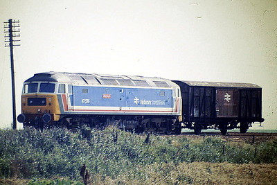 47576 KINGS LYNN approaches Horsemoor on 6H76 to Whitemoor, not a taxing load, 08/87. 47576 was built by Brush Falcon Works in 1964 as D1771 and was renumbered to 47176 in August 1973. It was ETHed and renumbered to 47576 in June 1980. It was withdrawn in December 2003 and scrapped in November 2005.