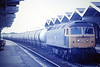 47050 passes through March Station on a train of Up Chemical Tanks, 05/85. 47050 was built by Crewe Works in 1964 as D1632 and renumbered in February 1974. It was withdrawn in December 1994 and scrapped in May 1996.