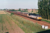 56056 approaches the A141 Bypass bridge on 6S93 Wisbech - Paisley petfood, 18/06/99.