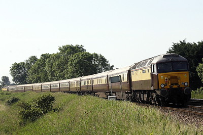 57313 SCARBOROUGH CASTLE passes Silt Road LC on the rear of 5Z72 Carnforth - Norwich 'Northern Belle' ECS, 57601 WINDSOR CASTLE at the head, 14/06/21. The train is due to work several East Anglian local trips today and tomorrow and then return to Chesterfield.