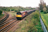58016 heads west past March West Junction on a train of ECC stone empties bound for Croft, 14/04/00.