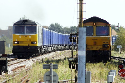 60055 THOMAS BARNARDO approaches March East on 6Z30 Brandon Down Sidings - Derby Chaddesden Sidings stone empties, 07/09/21. 66706 NENE VALLEY on the right is the Down Yard super shunter for today.