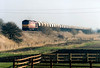 60053 NORDIC TERMINAL heads west past Beggars Bridge on 6E84 Middleton Towers - Monk Bretton sand, 21/02/03.