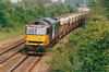 60008 GYPSUM QUEEN II heads west past March Station on the Trowse - Peterborough Redland Stone empties, 08/05/00.