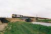 60054 CHARLES BABBAGE crosses Beggars Bridge on 6M70 Chesterton Junction - Mountsorrel Redland self-discharge stone empties, 13/03/02.