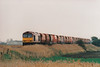 60048 EASTERN approaches Horsemoor on 6M87 Ely North Junction - Peak Forest RMC stone empties, 17/04/01.