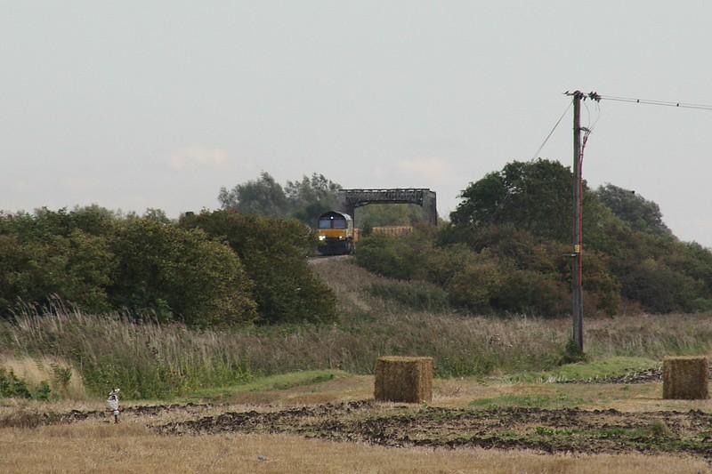 66846 passes over the Wash Bridges on 6L37 Hoo Junction - Whitemoor Yard, 23/09/15.